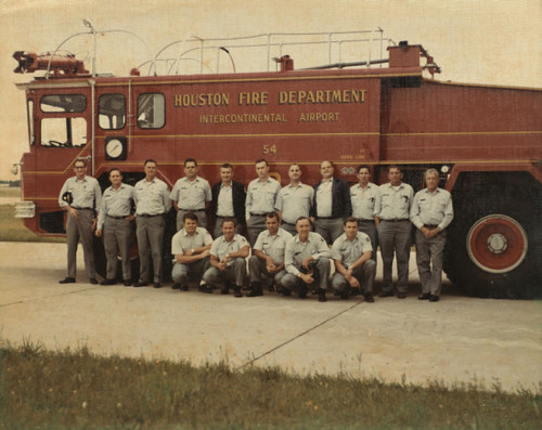 Station 54 firefighters standing next to crash truck