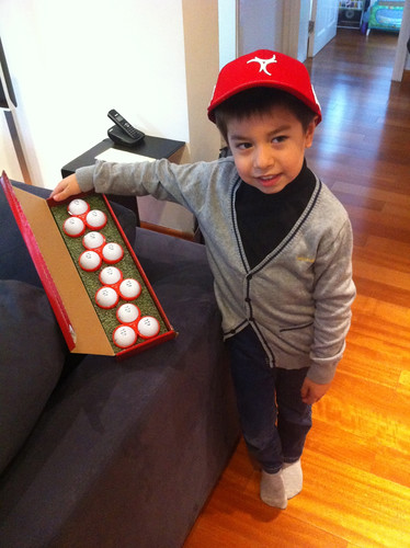Scott is happy with his golf balls & Redline golf cap