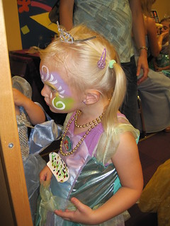 Kaitlyn age 3 looking at her facepaint - 07-17-10
