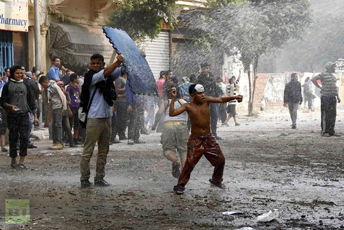 A young Egyptian protester throws a stone at anti riot policemen during clashes in the Cairo's Mohammed Mahmoud street on November 22, 2012. Egyptian protesters clashed with the police for a forth day. by Pan-African News Wire File Photos