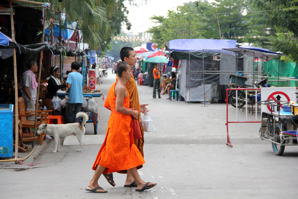 A group of monks out walking around the market