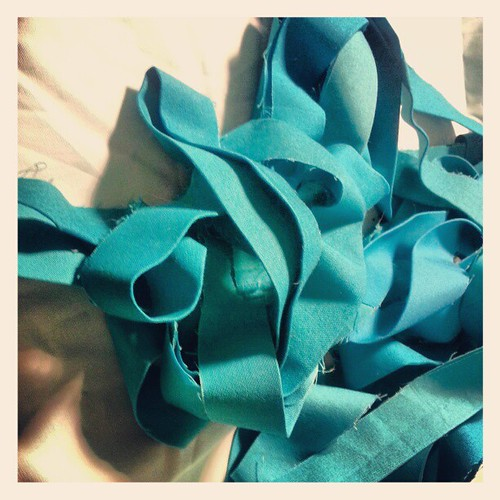 Binding pile. Four shades of turquoise.