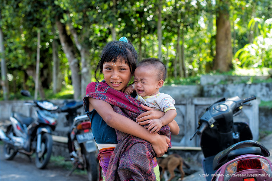 Girl posing with her young brother, Bali, Indonesia