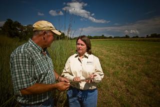 A farmer with a NRCS employee