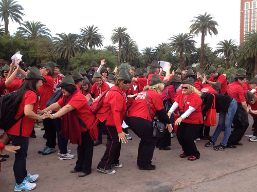 "Nurses dance in Robin Hood hats singing ""All I want for Christmas"" is to tax Wall Street."