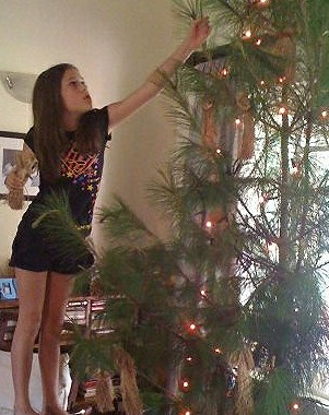 bella trims the Christmas tree