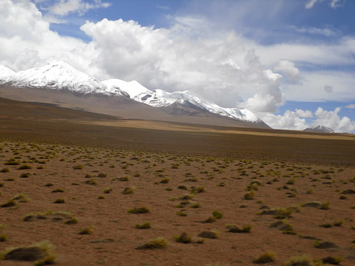 park trip travel vacation mountain snow mountains southamerica nature field clouds landscape nationalpark view cloudy culture bolivia adventure backpacking traveling altiplano mountaintop vast mountainrange potosi traveladventure travelinchucks travelinchicks
