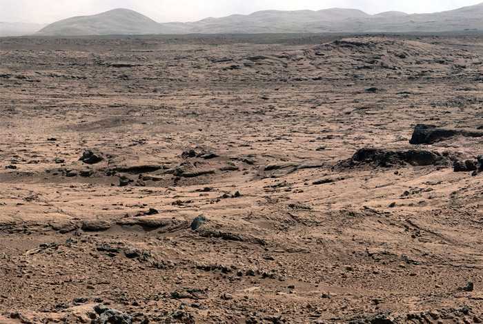 The Mars Science Laboratory's Curiosity Rover recently took this photo of the Martian landscape looking toward Mount Sharp while on its way toward Yellowknife Bay—an area where researchers have found minerals indicating the past presence of water. (NASA Photo)