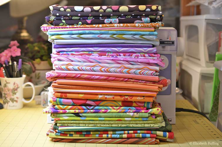 Stack of quilting cotton fabrics, Elizabeth Ruffing