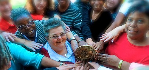 Terry shows her Minerva Award to the women at Crossroads, Inc.