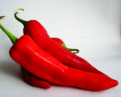 bell pepper(0.0), flower(0.0), plant(0.0), paprika(1.0), cayenne pepper(1.0), chili pepper(1.0), capsicum(1.0), vegetable(1.0), serrano pepper(1.0), tabasco pepper(1.0), peppers(1.0), red(1.0), bell peppers and chili peppers(1.0), bird's eye chili(1.0), peperoncini(1.0), produce(1.0), fruit(1.0), food(1.0), pimiento(1.0), malagueta pepper(1.0),