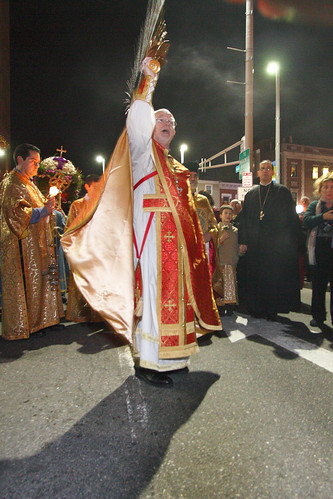 Fr. Antony Blessing the Processional Bier with Holy Water
