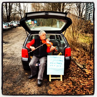 Violinist warming up in a church parking lot