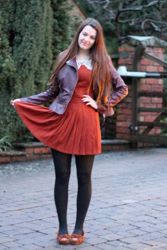 Fuse Fashion orange pearl collar dress, biker jacket, Minnetonka Moccasins