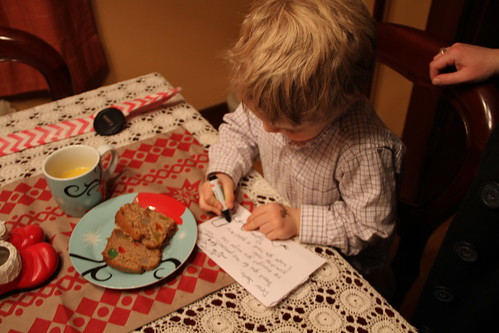 Writing his letter to Santa