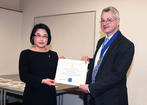 Dr Gary Simpson of Aston Business School presents Professor Lenny Koh with the Sheffield BGS Chapter Charter