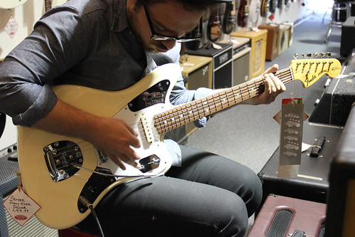 {JM playing (read: drooling over) a Fender Johnny Mar Jaguar guitar at Trutone in LA.}