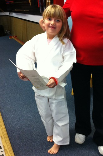 Catie's first karate lesson. The uniform is killing me, she's so cute.