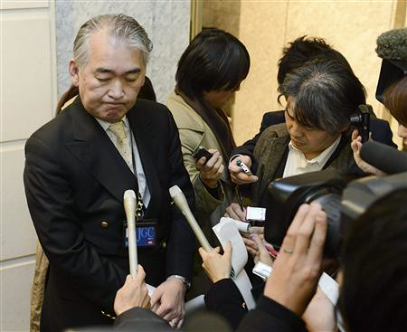 A Public Relations staff of JGC Corp answers reporters' questions regarding Japanese nationals who were kidnapped in Algeria, at its headquarters in Yokohama, south of Tokyo in this photo taken by Kyodo January 16, 2013. by Pan-African News Wire File Photos