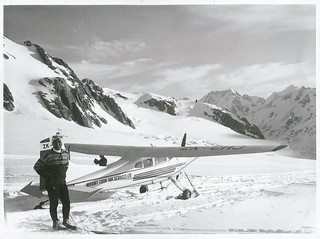 Yuichiro Miura Japan's top skier and ski instructor relaxes in front of a Mt. Cook Air Services Cessna 185 at the head of the Tasman Glacier. Mt. Cook.