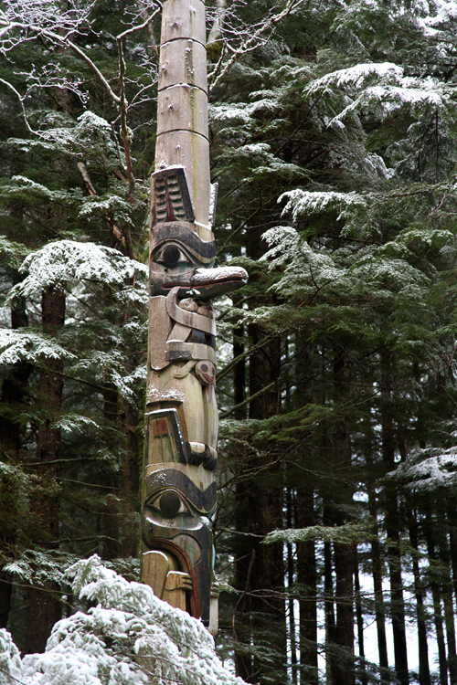 snow on a totem in the Totems Historic District, Kasaan, Alaska