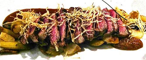 sliced steak and roast potatoes