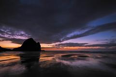 Taitomo Island sunset silhouette