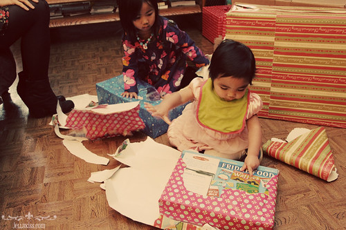 The girls opening gifts