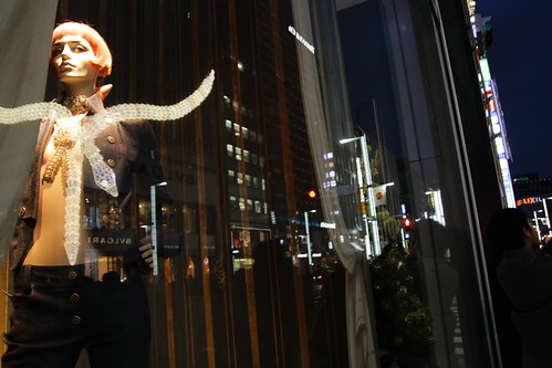 Mannequin looking at Bulgari building