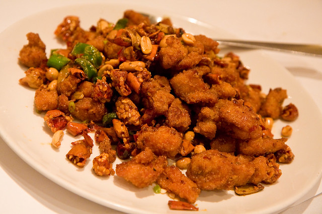 Smoky wok tossed diced chicken with thousand crispy chilis and peanuts, Land of Plenty
