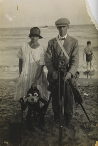 Beach photograph of a photographer, woman and Felix the Cat puppet by National Media Museum