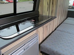 art(0.0), room(0.0), bumper(0.0), automobile(1.0), automotive exterior(1.0), furniture(1.0), countertop(1.0), vehicle(1.0), trailer(1.0),