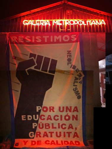 resistimos banner hung to finish drying at Galeria Metropolitana
