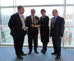 Baroness Warsi is presented with a Menorah