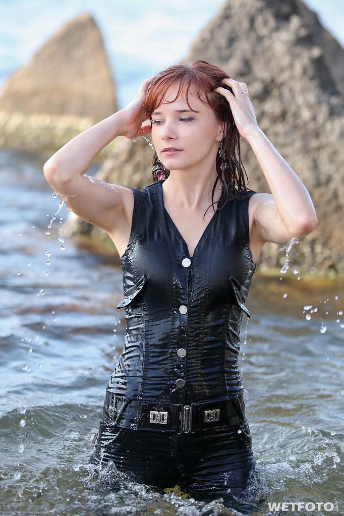 #240 Wetlook in Jeans Jumpsuit. Beautiful girl dressed in