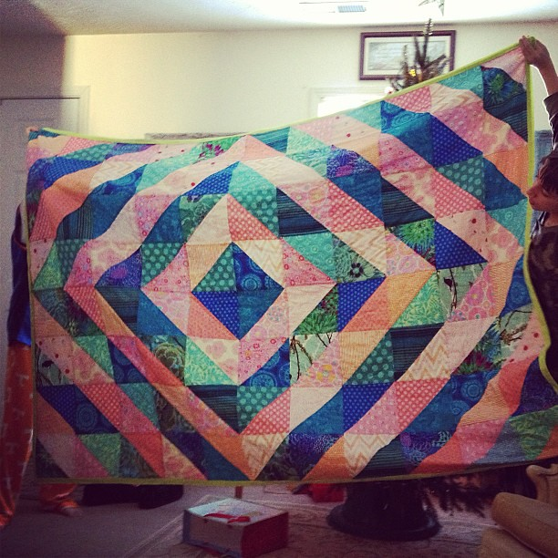The quilt reveal! (As held by the brothers)