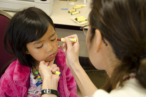 2012 - Professor Le face painting at a community health fair