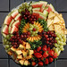 Artfully arranged seasonal fruit including pineapple, red ripe strawberries, cantaloupe, watermelon along with green and red grapes.  With Rinds 12 Inch (Serves 10 - 14)$29.99 16 Inch (Serves 16 - 20)$37.99 18 Inch (Serves 24 - 30)$47.99 24 Inch (Serves Up to 50$77.99  Without Rinds 12 Inch (Serves 10 - 14)$29.99 16 Inch (Serves 16 - 20)$39.99 18 Inch (Serves 24 - 30)$49.99 24 Inch (Serves Up to 50)$79.99