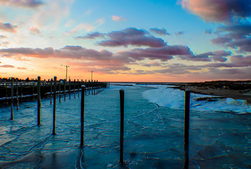 Rock Harbor Sunset on Ice by eHopePhotography