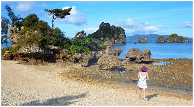 GIRL ON A BEACH AT THE LEPER COLONY in NORTHERN OKINAWA