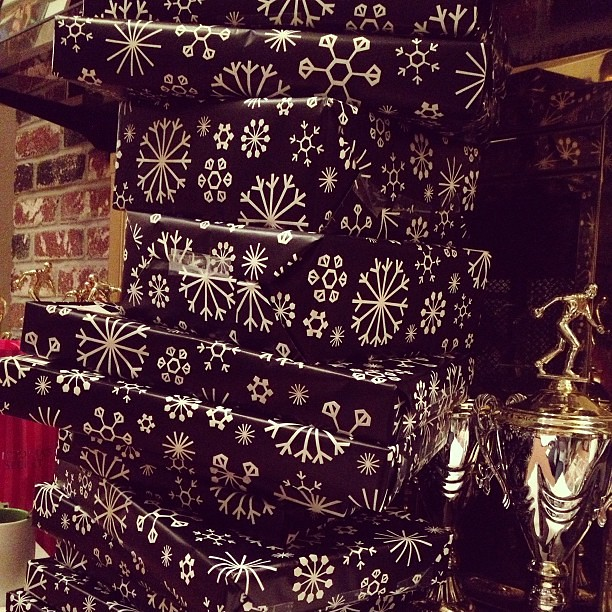 Christmas presents . Black wrapping paper.