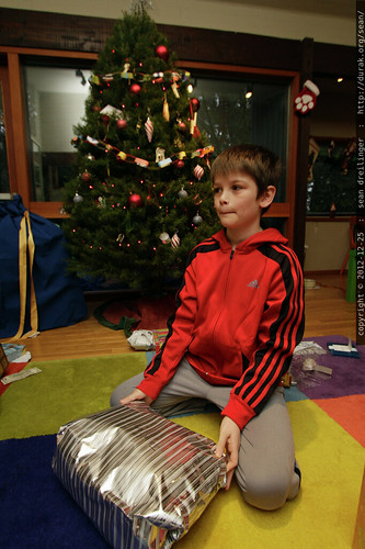 xmas 2012   our first wake up call arrived around 3:00am from an excited kid, but we held out for a 8:30am unwrapping ceremony.    MG 1111