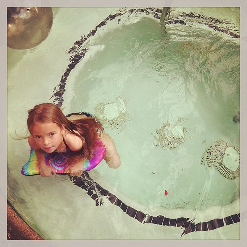It's 57 degrees and she wants to go swimming. I gave in and let her swim in the jacuzzi.