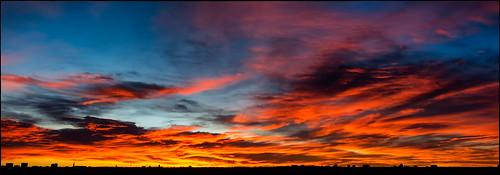 morning blue red sky panorama orange sun color skyline clouds sunrise canon buildings landscape fire colorado pano scenic denver panoramic rays blaze 1740 ablaze 60d rubyhillpark