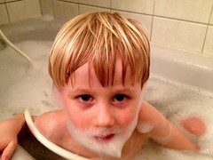 child, hand, nose, face, hairstyle, finger, skin, lip, head, hair, ear, cheek, bathing, blond, mouth, pink, boy, toddler, eye, organ,
