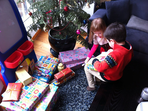 Scott and Elaine unpacking the presents at Christmas morning