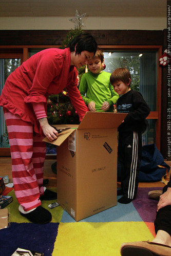 xmas 2012   our first wake up call arrived around 3:00am from an excited kid, but we held out for a 8:30am unwrapping ceremony.    MG 1143