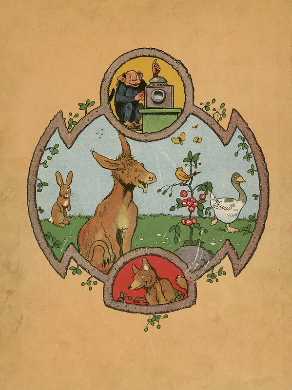 bordered cartouche of cartoon smiling animals around donkey
