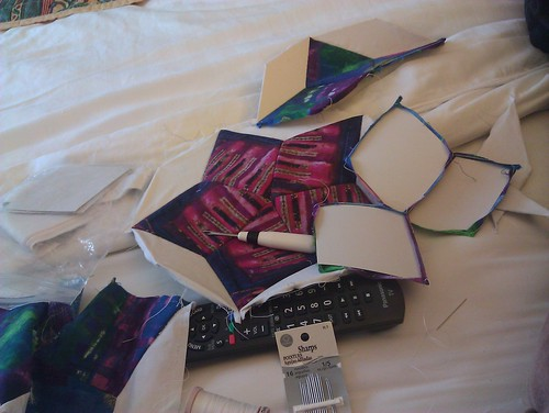 sewing peacefully on the hotel bed.