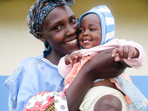 A mother and child stand outside a health clinic where they both received check-ups and necessary vitamins and vaccines.  Great Rift Valley Region, Kenya